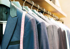 Suit. Row of men's suits hanging in closet stock photos