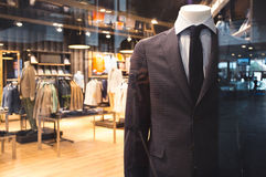 Suit in shop of men's business wear Royalty Free Stock Photos
