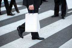 Suit with shopping bag Royalty Free Stock Photography