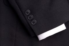 A suit sleeve with a white cuff. Closeup of a suit sleeve with a white cuff royalty free stock photography