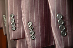 Suit sleeves. Modern and city looking pinstripe suit sleeves with buttons Royalty Free Stock Image