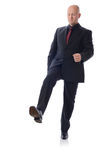 Suit stepping on something. Man in suit stepping on something  on white Stock Photos