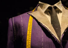 Suit on Tailor's Dummy. Work in Progress Suit on Mannequin with Yellow Tape Measure Stock Images