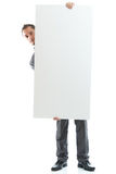 Suit tie businessman displaying placard Stock Photo
