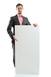 Suit tie businessman displaying placard Stock Image
