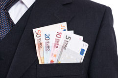Suit with tie and euro notes Royalty Free Stock Photos