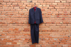 Suit on a wall Royalty Free Stock Photography