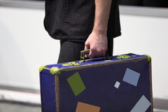 Suitcase. Is in the hand of man Royalty Free Stock Images