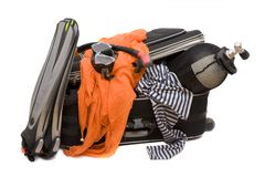 Suitcase. Lots of things for trip in small suitcase Royalty Free Stock Images