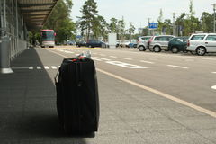 Suitcase. Travel bag in station Royalty Free Stock Photos