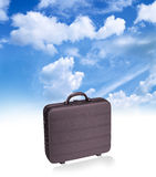 Suitcase. Businessman suitcase on white - moving clouds back Royalty Free Stock Photos