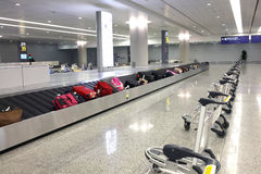 Suitcase on airport carousel Royalty Free Stock Photo