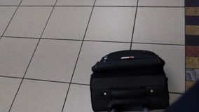 Suitcase in an airport. Footage of a carry on suitcase being pulled through an airport stock video footage