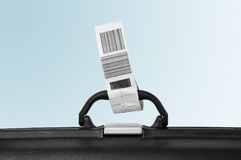 Suitcase attached with airline label Royalty Free Stock Photos