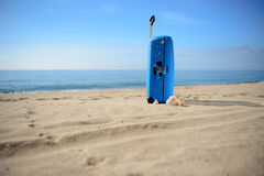 Suitcase on the baech, travel, background. Blue suitcase on the baech, sea view Stock Photography