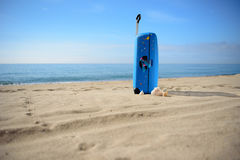 Suitcase on the baech, travel, background. Blue suitcase on the baech, sea view Stock Image