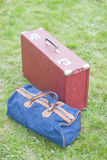 Suitcase and bag for travel. On the grass Royalty Free Stock Photography