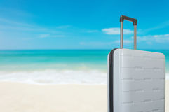 Suitcase baggage on the sand on the beach Royalty Free Stock Image