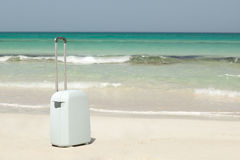 Suitcase on the beach Stock Images