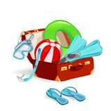 Suitcase with beach accessories Stock Photography