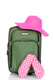 Suitcase with beach hat and sandals stock photo