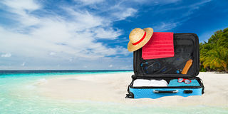 Suitcase beach Stock Images