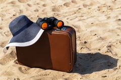 Suitcase on the beach Stock Photography