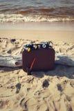 Suitcase on the beach Stock Photos