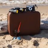 Suitcase on the beach Stock Photo