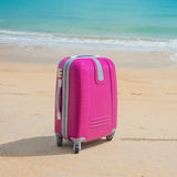 Suitcase at the beach Royalty Free Stock Photo