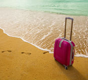 Suitcase on the beach with white sand Royalty Free Stock Photography