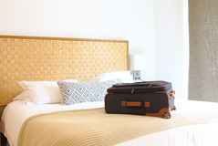 suitcase on the bed inside a hotel room Stock Image