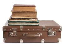Suitcase and book Stock Image