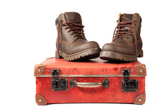 Suitcase and boots Royalty Free Stock Image