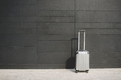 Suitcase of a business woman on wall background Royalty Free Stock Photography