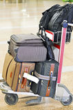 Suitcase Cabin Bags, laptop bag & Backpacks Placed on Trolley Royalty Free Stock Photography