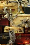 Suitcase Christmas tree detail. Details of traveling bags and suitcases piled up and decorated as a Christmas tree Royalty Free Stock Images