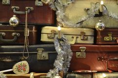 Suitcase Christmas tree details landscape. Landscape view of traveling bags and suitcases piled up and decorated as a Christmas tree Royalty Free Stock Photo