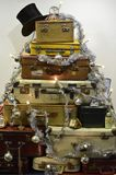 Suitcase Christmas tree. Traveling bags and suitcases piled up and decorated as a Christmas tree Royalty Free Stock Photos