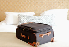 suitcase close-up on the bed inside a hotel  room Royalty Free Stock Image