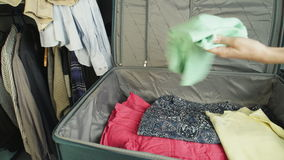 Suitcase with clothes stock footage
