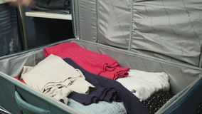 Suitcase with clothes stock video