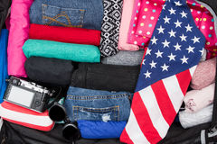 Suitcase, clothing and flag Stock Photos