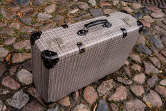 Suitcase on cobble stone Royalty Free Stock Photography