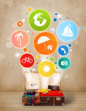 Suitcase with colorful summer icons and symbols Stock Photo