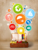 Suitcase with colorful summer icons and symbols Stock Images