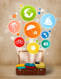 Suitcase with colorful summer icons and symbols Royalty Free Stock Image