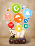 Suitcase with colorful summer icons and symbols. On grungy background Stock Photos