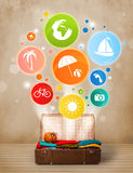 Suitcase with colorful summer icons and symbols Royalty Free Stock Photos