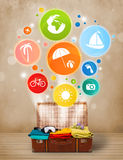 Suitcase with colorful summer icons and symbols Stock Photography